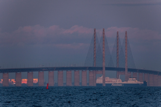 The Finnlines' ro/pax passes under the Øresund Bridge towards Malmø.