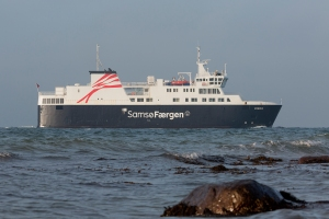 The ferry is photographed from the coastline just east of Kolby Kaas harbour a December morning.