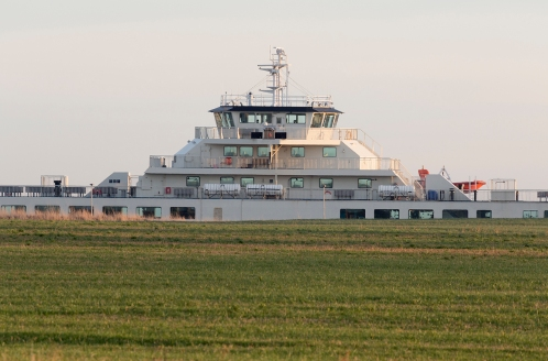 SAMSØ appears behind a field at the new Ballen ferry harbour.
